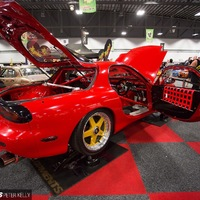 Red 1994 Mazda RX-7 on Gold Mazdaspeed MS-01