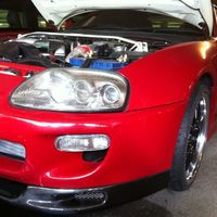 Red 1995 Toyota Supra on Black Cruize 190