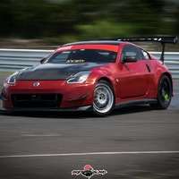 Red 2004 Nissan 350Z on Silver/Chrome Enkei NT03+M