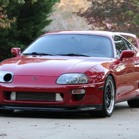 Red 1995 Toyota Supra on Black CCW Classic
