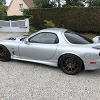 Gray 2000 Mazda RX-7 on Bronze Volk Racing ZE40